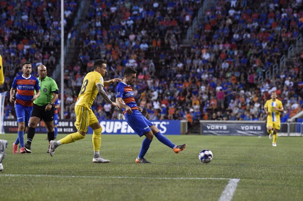 Tyler Gibson dribbling a soccer ball.