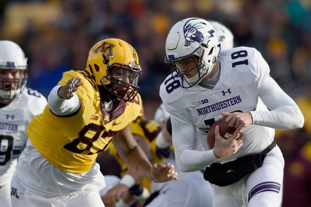 Gaelin Elmore rushing the passer during a game versus Northwestern.