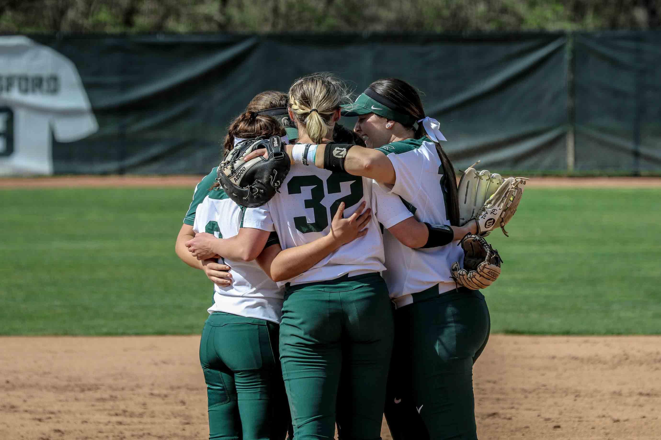 Bridgette Rainey huddling with her teammates.