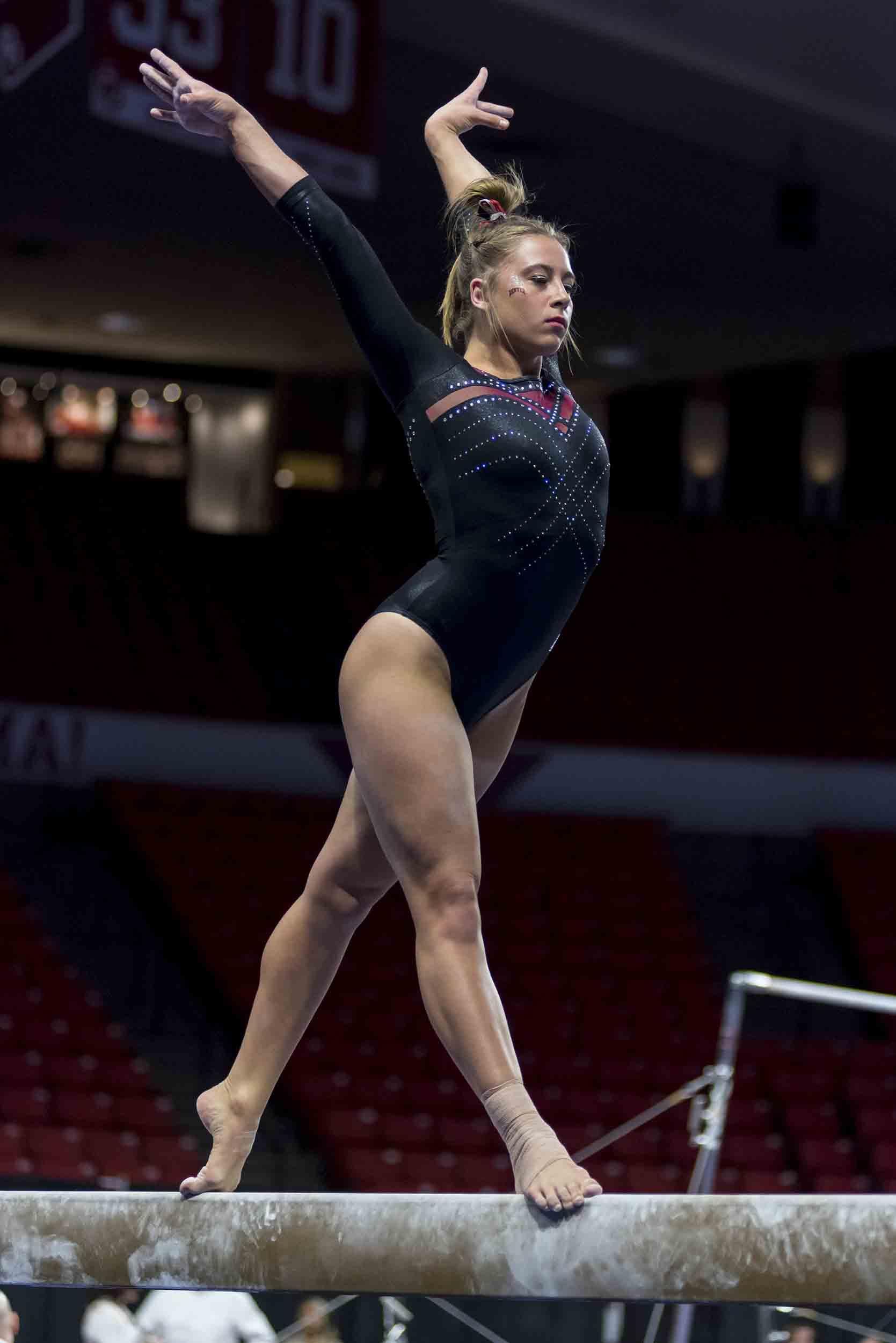 Maddie Karr on the balance beam.