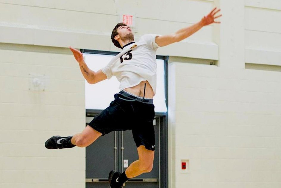 Keaton Strom jump-serving.