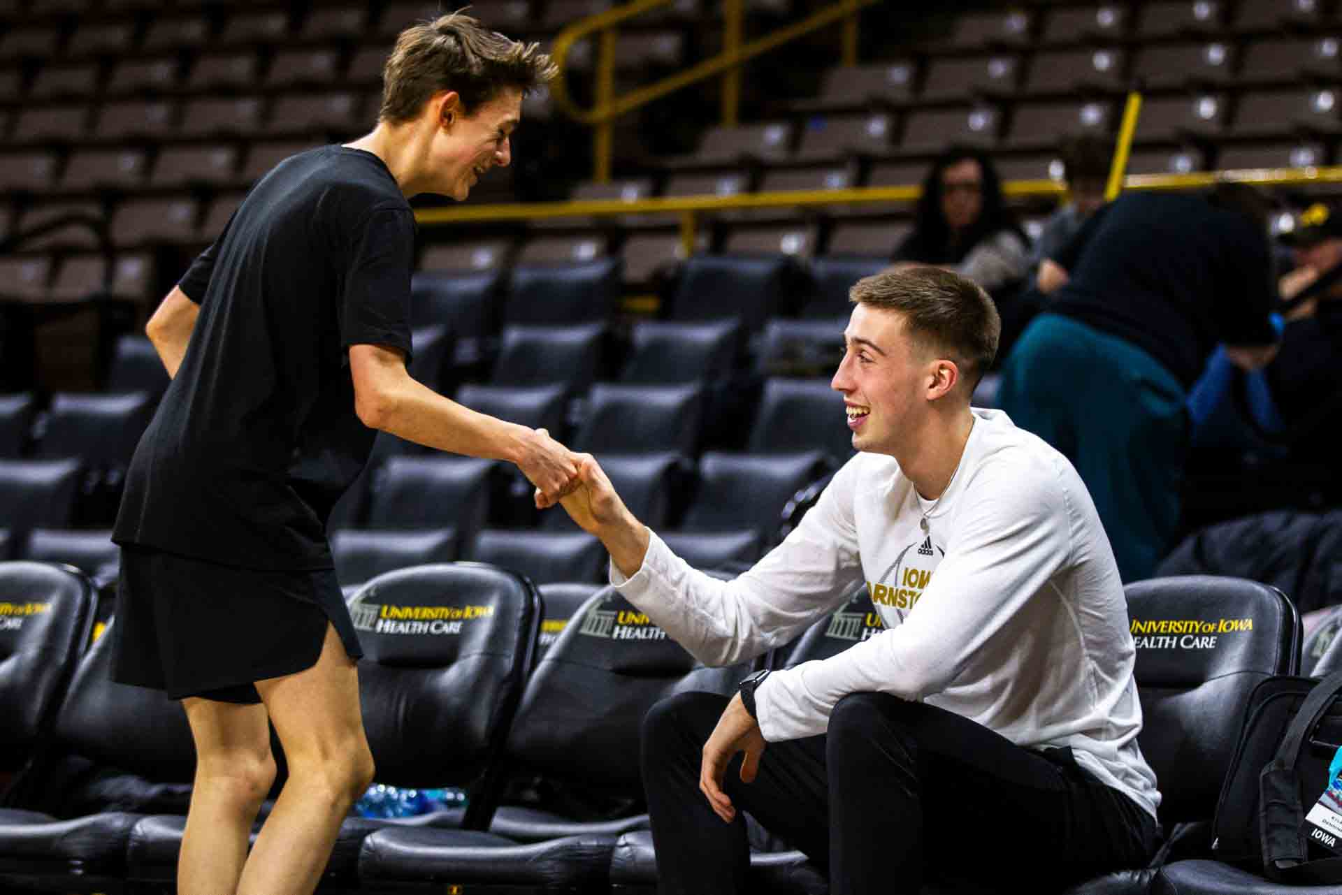 Dylan Mihalke talks with Iowa guard Joe Wieskamp.