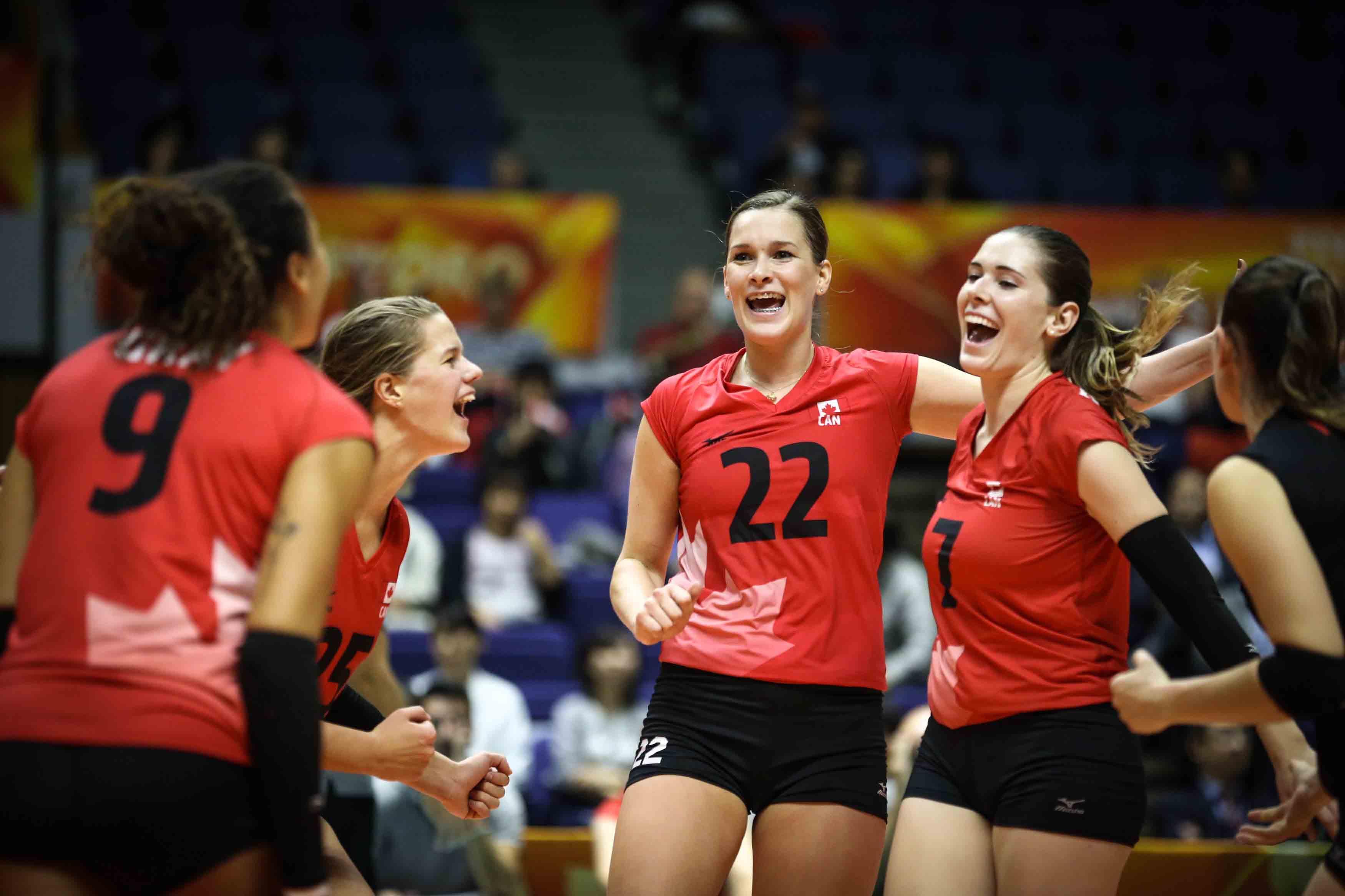 Megan Cyr celebrating a point with teammates.