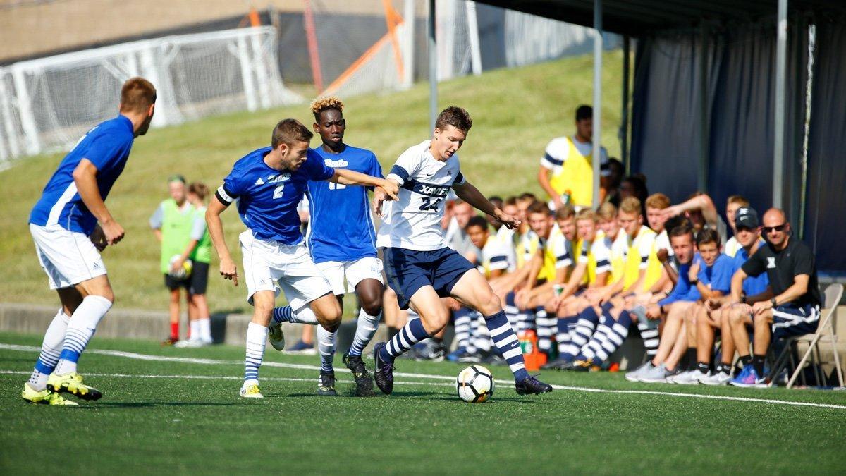 Samson Sergi dribbling a soccer ball.